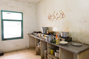 The communal kitchen in a half-finished building that houses Syrian families. The rent is high, almost unaffordable for many families in the building. Many large and extend families have to share a room. Some have to share with a family they've never known before fleeing Syria. The is no privacy, no respite for anyone. © David Brunetti