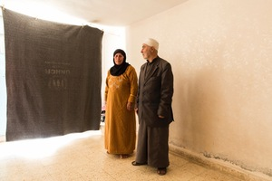 Nasser and Hiba in their new temporary home in Azraq – they didn't want to leave Syria but their children convinced them otherwise when a bombing attack destroyed their home and killed their neighbours. They now live in a basement room with their children's families. © David Brunetti
