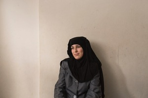 Dina, a mother of three, who now lives with her family in Azraq, Jordan worries about relatives who stayed behind every day. Even though life is difficult for her family in Jordan she hopes they will eventually join her in Jordan. © David Brunetti