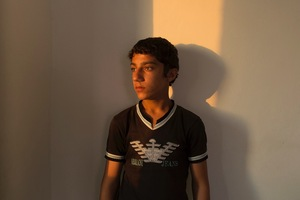 """Fadi from Dara'a hasn't been to school since arriving in Jordan. While more than 90% of Syrian children were enrolled in school before the war; only one in three of the refugees attend class in Jordan. """"I had a better life in Syria with my parents and my friends,"""" he said. """"I just want to go to school."""" © David Brunetti"""