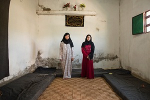 Reem and Noor are sisters in law who share this bare two-room apartment in Azraq with their extended family. The family is struggling to make ends meet and is barely able to afford the rent with the cash assistance and food coupons they receive from UNHCR but they are glad that their young children are now safe. © David Brunetti