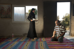 "Iman Serving Her Father From the series ""Eighteen"" © Natan Dvir"