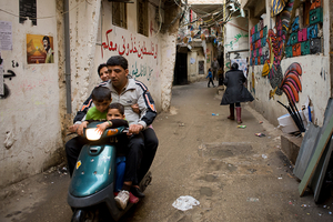 Motorcycles are the most common means of transportation on the streets of Shatila. 2013 © Gloriann Liu