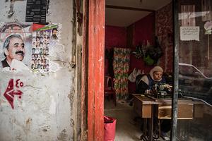 Clothing repairs. 2013 © Gloriann Liu