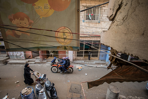 View from a window in Ahlam Laja' school (Dreams of Refugees). A new school in Shatila, started 3 years ago by five young men. It began with 30 students and now the enrollment is 400. There is a waiting list of hundreds. The teaching methods used in the school are primarily based on the Performing Arts. There is now hope for many of the students to continue their education in local Universities. Several of the students received scholarships last year. Many families now have a new hope for the future of children in the camp. 2013 © Gloriann Liu