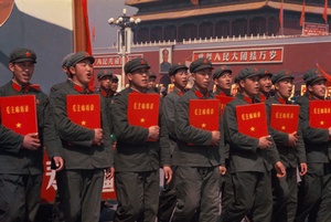 "© WENG Naiqiang, Red Guards carrying the ""Quotations of Chairman Mao."" Parade on Tiananmen Square on National Day, Beijing, 1966Courtesy of 798 Photo Gallery, Beijing"