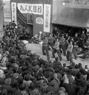 """© WANG Shilong, College students of """"Chairman Mao's Thoughts Propaganda Team"""" dance and sing revolutionary songs for the people in Henan province, 1972Courtesy of 798 Photo Gallery, Beijing"""