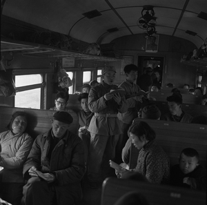 """© XIAO Zhuang, Reading """"Quotations of Chairman Mao"""" on the train, 1966Courtesy of 798 Photo Gallery, Beijing"""