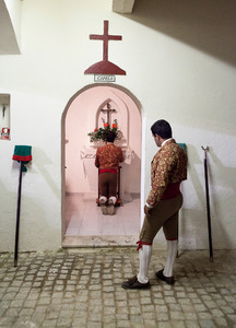 Guga Oliveira, one of the members of the group of Forcados of Évora, looks to another member of the group while he prays before the bullfight. Forcados are extremely religious. © Eduardo Leal
