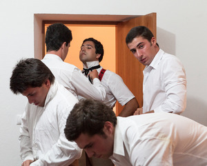 Members of the group of Forcados of E?vora dress themselves in the house of an ex-forcado before the bullfight. When the arenas don't have dressing rooms, groups use the house of friends or old members to keep the costs down. © Eduardo Leal