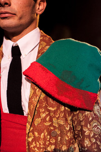 Detail of the forcado's jacket and hat. The hat is never washed, the bloodstains testify the forcados experience. © Eduardo Leal