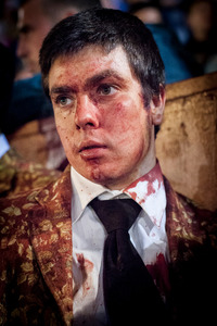 José Martins, member of the Forcados of Évora, is lost in thoughts after a difficult catch of the bull. He was only able to catch the bull after three attempts. © Eduardo Leal
