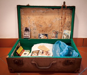 A suitcase belonging to one of the forcados. Forcados are extremely  religious. © Eduardo Leal