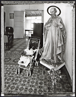 Baby Carriage and the Saint, Trinidad, 2002. © Elaine Ling