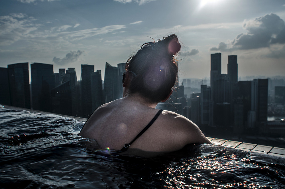 Future is getting harder,Waddling chest deep in the highest swimming pool of the world, I pause in amazement in the far distant horizon and studied the intense changes made to the landscape of Singapore. She too paused.Who would have imagined how far we would come. What we had to lose to come this far and what could we gain in the future? © Amrita Chandradas