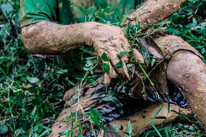Gravedigger cleaning off his hands after exhumation ritual© Amrita Chandradas
