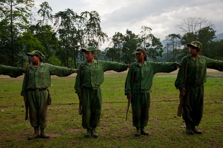 Women for a line at the KIA's military base outside of Laiza, Kachin State, Myanmar, May 17, 2013. The women were strongly committed to the Kachin people and many said that they were not scared to risk their lives in the KIA's struggle for autonomy.